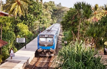 BENTOTA, SRI LANKA - APR 28: New Sri Lanka Railways class S12  train on Apr 28, 2013 in Bentota, Sri Lanka. It is a part of government 10-year Railway Development Strategy and new trains are using from 2012.