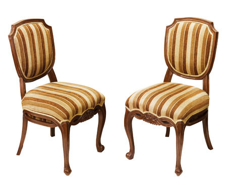 Antique striped wooden chairs isolated on white background photo