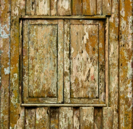 Shuttered window of old wooden grunge house photo