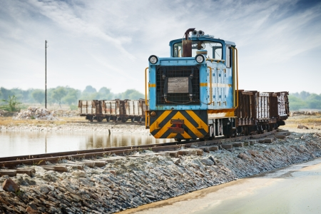 Old small locomotive and freight train close up. India photo