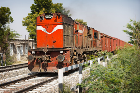 Old locomotive pulling freight train. India photo