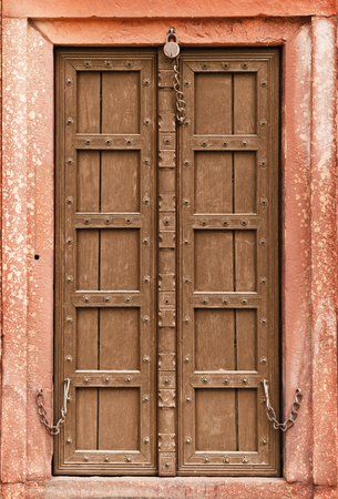 Old wooden door - a part of Indian architecture photo
