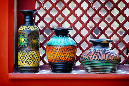 Vintage color vases on the windowsill. India photo