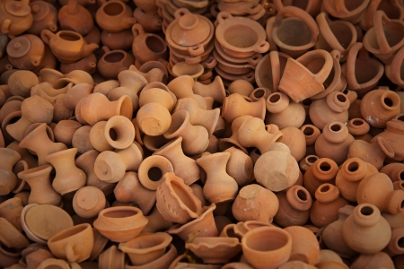 Big pile of clay pots on the open market photo