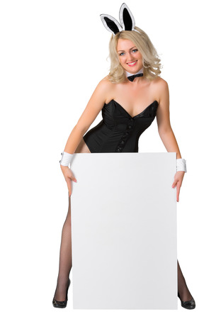 Beautiful blonde in a bunny suit with vertical banner on white background photo
