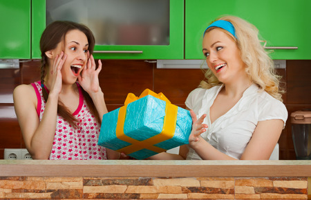 gives: Girlfriend gives a gift box at a party