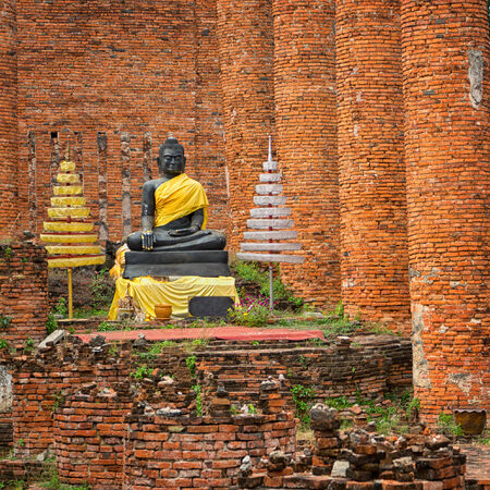 Old Buddha statue in the temple ruins. Ayuthaya, Thailand photo