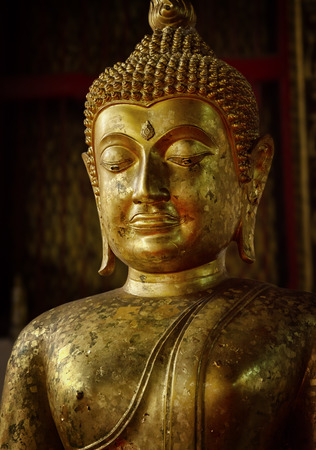 close up image: Old statue of Buddha in a temple room  Thailand, Ayuthaya