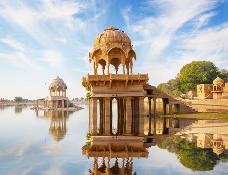 Indian landmarks - Gadi Sagar temple on Gadisar lake -  Jaisalmer, Rajasthan, north India photo