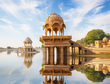 Indian landmarks - Gadi Sagar temple on Gadisar lake -  Jaisalmer, Rajasthan, north India