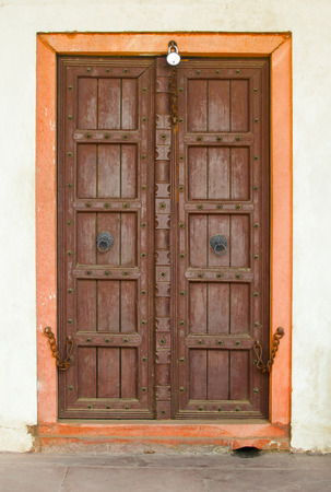 The old wooden door on a building facade  India, Agra photo