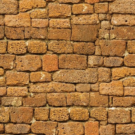 Seamless vintage pattern - old brown rough natural stone wall photo
