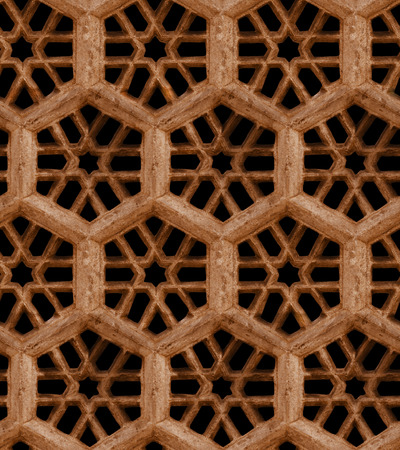Seamless Indian pattern  Ancient traditional ornament - brown sandstone grill on black background photo