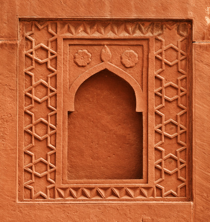 Decorative element in the form of a window on the wall of an ancient palace  India, Agra photo