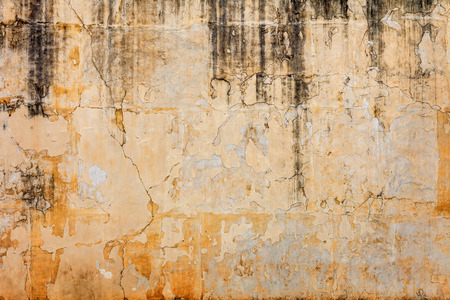 Old concrete wall with peels off paint - grunge background photo