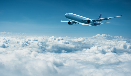 jetliner: Passenger plane flies above the clouds - air travel