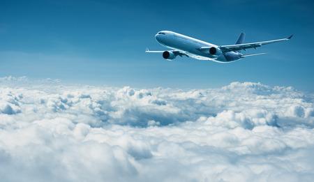 jetliner: Passenger plane flies above the clouds - air travel