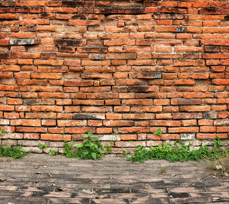 Old brick wall and sidewalk - architectural background photo