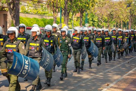 penh: PHNOM PENH, CAMBODIA - 29 DEC 2013: Cambodian riot police march on a central streets Editorial