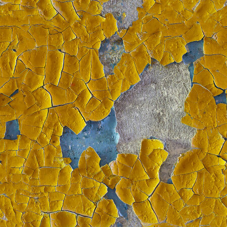 uneven: Cracked old yellow enamel on surface of wall - seamless pattern