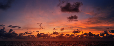 Picturesque beautiful panoramic view of the sky at sunset over tropical ocean photo
