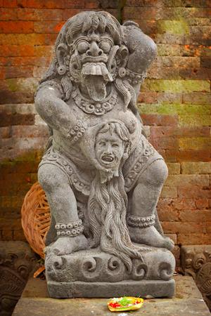 Vintage statue of the deity child-eating Rangda. Indonesia, Bali island photo