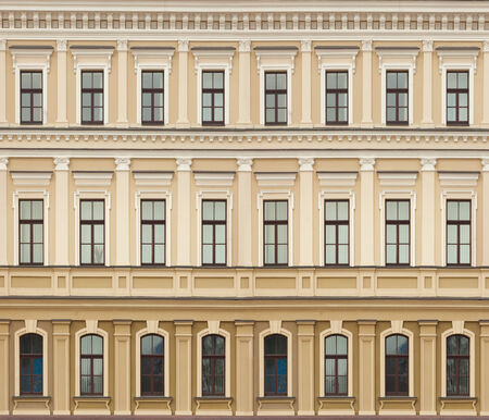 neoclassic: Neoclassic architecture wall with windows vintage building background Stock Photo