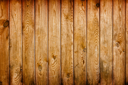 Wall covered with brown grunge wooden boards - a natural background. Stok Fotoğraf