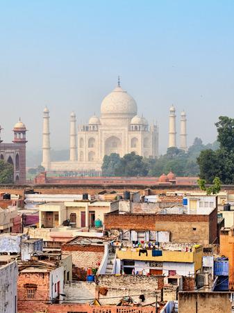 agra: Poor neighborhoods of the city and luxurious Taj Mahal. Agra, India
