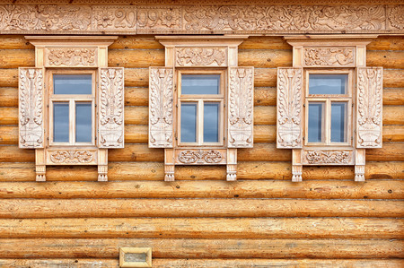 The windows on the facade of the wooden house. Old Russian country style photo