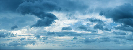 Panorama of beautiful cloudy sky over the sea horizon photo
