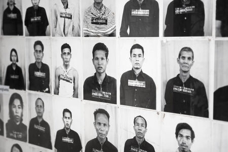 penh: PHNOM PENH, CAMBODIA - CIRCA DEC 2013: Portraits of prisoners in the old prison - museum