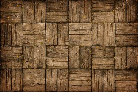 alternating: Background, depicting an old, weathered, parquet style wooden deck with alternating woodgrain pattern. Stock Photo
