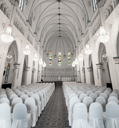 public private: Interior of the historic, gothic-style chapel in downtown Singapore. This place serves as a venue for both public and private events.