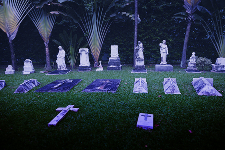 illuminator: SINGAPORE - 31 DEC 2013: Ancient headstones mark graves at this cemetery near the Armenian Church Of St. Gregory The Illuminator in Singapore. Editorial