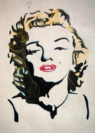 MALAYSIA, PENANG, GEORGETOWN - CIRCA JUL 2014: Lifesize painted mural featuring an iconic image of Marilyn Monroe in color.