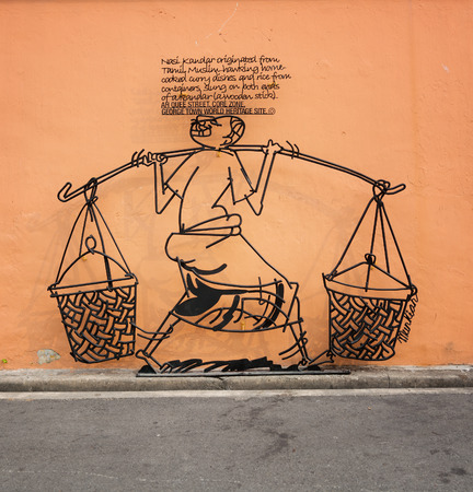 culinary tourism: MALAYSIA, PENANG, GEORGETOWN - CIRCA JUL 2014: An artistic sign, made of formed metal, explains an important local cultural tradition for tourists. Editorial