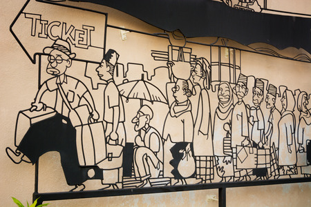 heritage site: MALAYSIA, PENANG, GEORGETOWN - CIRCA JUL 2014: Cartoon style image of caricatures standing in line, waiting for transportation. Editorial