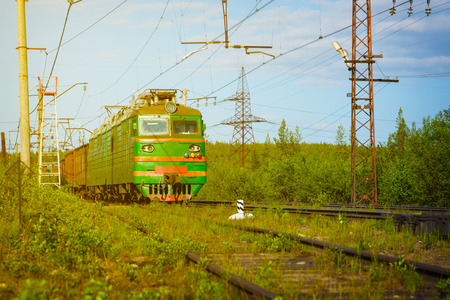 engine powered: Electric freight train crossing the Russian countryside as it approaches Polyarnye Zori, in the Murmansk region of Russia.