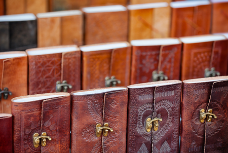 tooled: Beautiful, intricately detailed leatherwork on the bindings of these souvenir notebooks at a vendors stall in Udaipur, India. Stock Photo