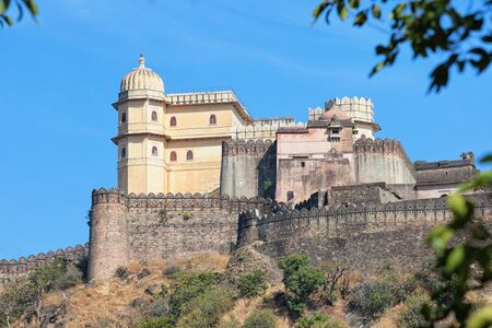 15th century: Inspiring view of the imposing facade of Kumbhalgarh Fortress, a 15th century redoubt and a world heritage site near Udaipur, India.