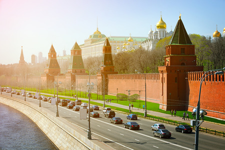 moskva river: Beautiful architecture of The Kremlins fortified complex, palace and golden onion-domed cathedrals, with the Moskva River on the left.