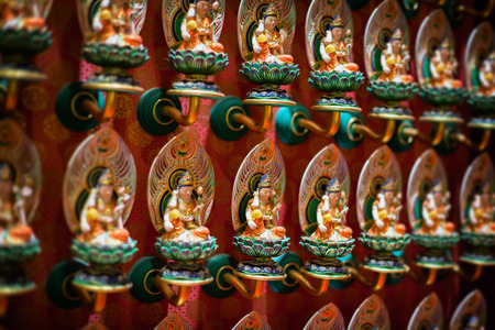 colorfully: Rows of Beautiful, intricately carved and colorfully painted, identical sculptures inside the Buddha Tooth Relic Temple in Singapore.
