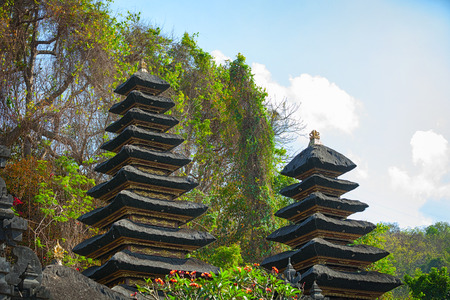tiers: Heaps of guano cover the many tiers of these shrines at Goa Lawah Bat Cave Temple, in Bali, Indonesia.
