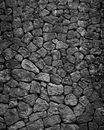 granite wall: Mosiac hand crafted gray solid granite stone wall background.