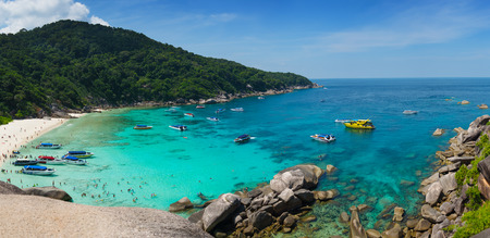 Rugged coast line in the Similians with sandy beach and beautiful turquoise water. Stock Photo