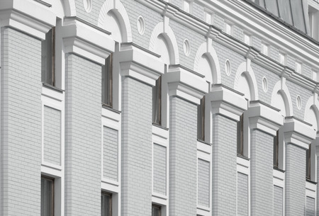 keystone: Corintian style architecture with keystone arches and recessed circular features.