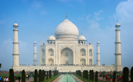 mughal architecture: Unique, white marble, Mughal architecture of the Taj Mahal, an ancient mausoleum and tomb, with its domes and minarets. Stock Photo