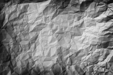 wadded: Background photo picturing a formerly crumpled piece of paper, smoothed out again with interesting shadow effects from indirect lighting. Stock Photo