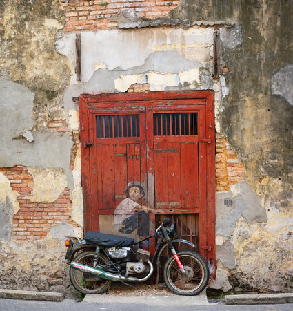 ernest: GEORGE TOWN, PENANG, MALAYSIA - CIRCA JUL 2014: Street Mural Boy on a bike painted by Ernest Zacharevic.